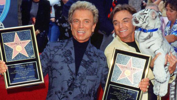 Siegfried Fischbacher (izquierda) y Roy Horn (derecha) eran reconocidos por sus shows en Las Vegas. (Foto: Chris DELMAS / AFP)