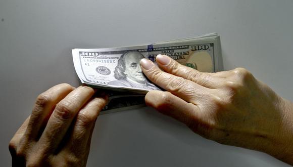 El dólar cerró a la baja el martes. (Foto: Richard Hirano | GEC)