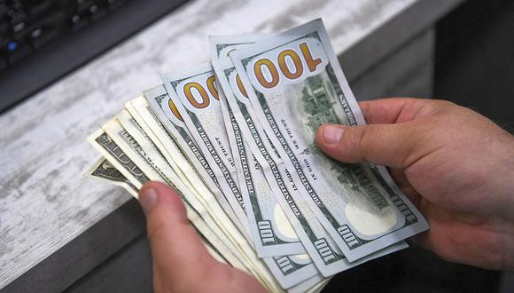 A las 9:49 a.m., el tipo de cambio se cotizaba a S/ 3.644 en el mercado interbancario, una subida de 0.11% en comparación a los S/ 3.640 del cierre del jueves, según datos de Bloomberg. (Foto: AFP)