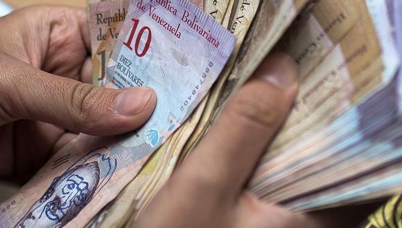 """El economista Ángel Alvarado asegura a Efe que la alta inflación, un indicador que al que la oposición de Venezuela suele anteponer el prefijo """"hiper"""", es el mayor de los males de la economía del país caribeño. (Foto: AFP)"""