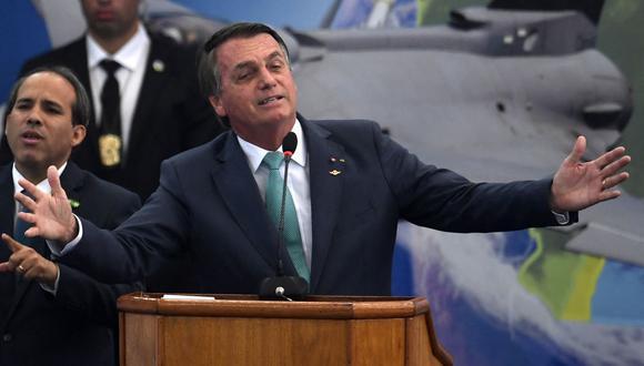 Jair Bolsonaro se encuentra en la mira por vetar ley de normas de seguridad. Según el ejecutivo, falta aclaraciones sobre las sanciones. (Foto: MAURO PIMENTEL / AFP)