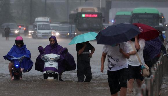 Según el Diario del Pueblo, estas lluvias han provocado el hundimiento de viviendas.  (Foto: STR / AFP)