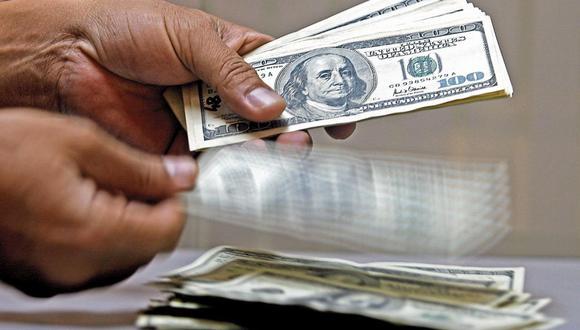 El dólar acumula una ganancia de 9.84% en el mercado cambiario en lo que va del 2021. (Foto: AFP)