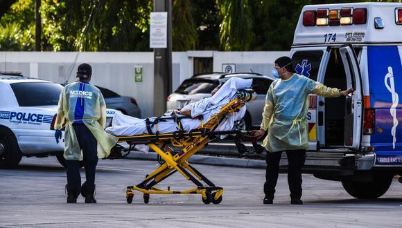 El cuarto de millón de decesos se producen cuando EE.UU. está experimentando una explosión de infectados con cerca de 150.000 diarios y un nivel de muertes solo visto durante la primavera pasada. (CHANDAN KHANNA / AFP).