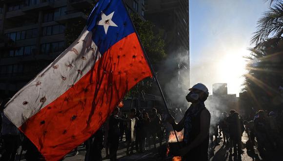 A un año de la crisis social que sacudió todo Chile. (Johan ORDONEZ / AFP)