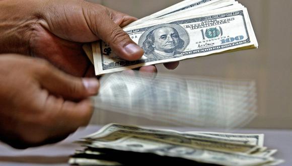 A las 9:21 de la mañana, el precio del dólar se situaba en S/ 3.6010 en el mercado interbancario, un nivel mayor en 0.36% frente a los S/ 3.5880 del cierre del lunes. (Foto: AFP)