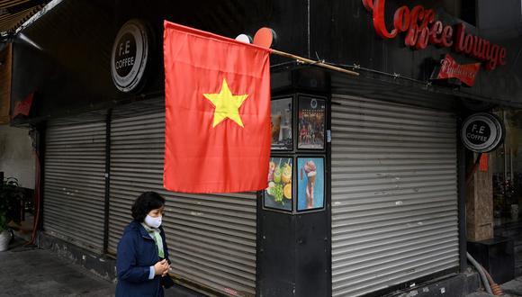 Desde la semana pasada, los vietnamitas recibieron hasta tres SMS exhortándolos a contribuir a un fondo para la vacuna anti COVID-19. (Foto referencial / AFP / Manan VATSYAYANA)