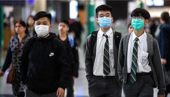 Ciudadanos chinos usando mascarillas para disminuir las posibilidades de contagio por cualquier virus. Foto: AFP