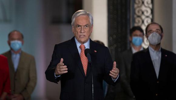 El presidente de Chile, Sebastián Piñera, habla en el palacio presidencial de La Moneda, en Santiago. (AFP/CLAUDIO REYES).