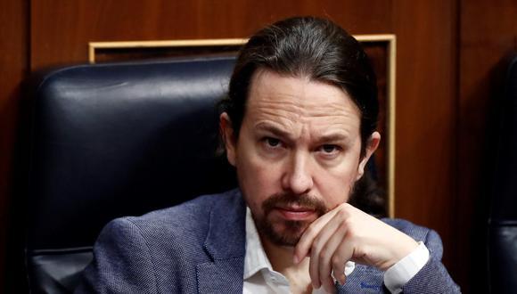 """Pablo Iglesias, quien ya había abandonado en marzo una de las vicepresidencias del ejecutivo del socialista Pedro Sánchez para competir en Madrid y tratar de impulsar a su partido, afirmó que """"cuando uno deja de ser útil, tiene que saber retirarse"""". (Foto: Mariscal / POOL / EFE / AFP)"""