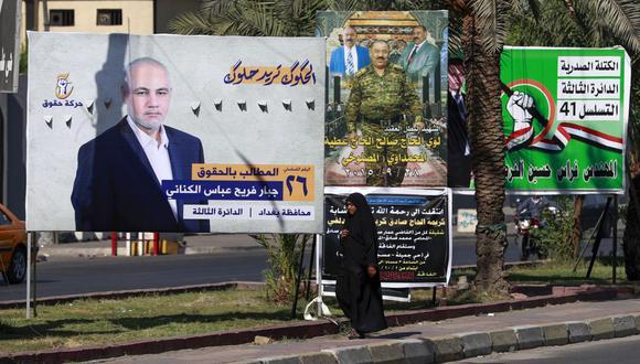 Los iraquíes elegirán un nuevo parlamento mañana, dos años después de una ola de protestas contra el gobierno. barrió el país marcado por la guerra, pero los analistas dicen que es poco probable que la votación produzca un cambio importante. (Foto de AHMAD AL-RUBAYE / AFP)
