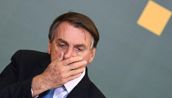 """Desde que Jair Bolsonaro asumió el cargo, los indígenas brasileños han presentado tres denuncias contra él ante la CPI por """"ecocidio"""" o """"genocidio"""". (Foto: EVARISTO SA / AFP)"""
