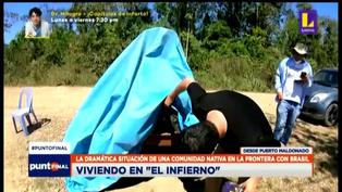 Niños se cubren con un plástico para estudiar sus clases virtuales bajo la sombra en Puerto Maldonado