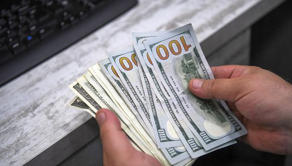 En el mercado paralelo o casas de cambio de Lima, el tipo de cambio se cotizaba a S/ 3.620 la compra y S/ 3.650 la venta. (Foto: AFP)