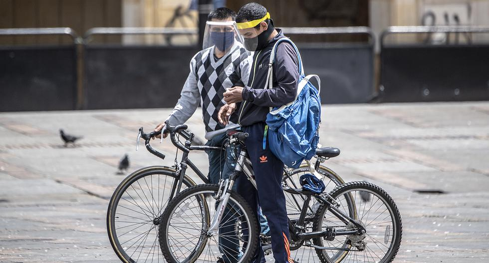 """Duque recalcó que la prolongación del aislamiento preventivo obligatorio tendrá """"unas modificaciones que son importantes en lo que tiene que ver con recuperación de vida productiva y también de otros espacios de calidad de vida"""". (Foto: Juan BARRETO / AFP)"""